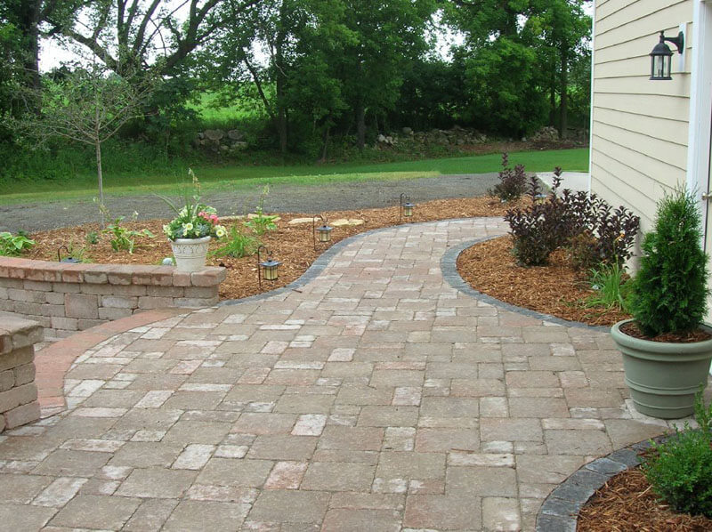 Stone Patio Lined with Garden Beds