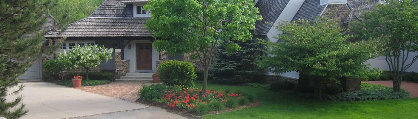 Front Yard with Lush Gardens and Trees